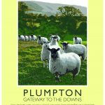 Poster of picture which features on front page of Plumpton Walks booklet. It is a picture of a field of sheep and has the words PLUMPTON Gateway to the Downs written at the bottom of the poster